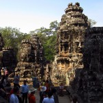Tourists wander the upper level of the Bayon