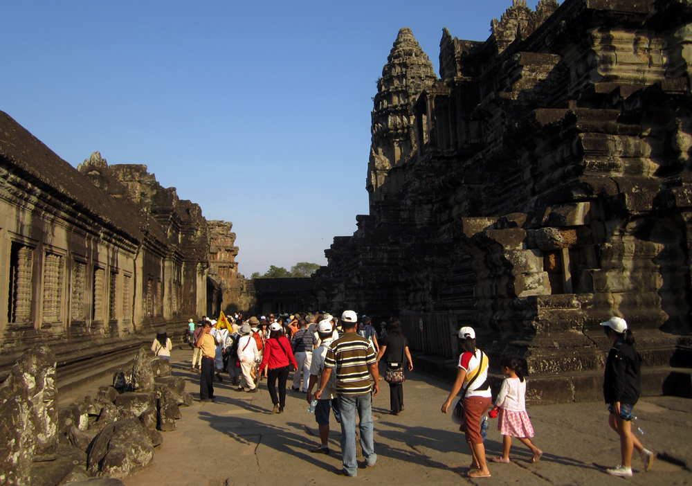 Tourists on the middle level of Angkor Wat.