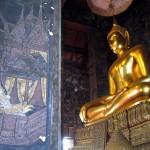 Wat Suthat murals surround Buddha