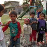 A playgroundful of kids rushed over to talk to us