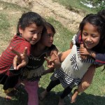 Kids strike a pose for the camera as we make our way back to Pokhara