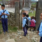 We shared our walk with numerous schoolkids, one of whom (Sam) we decided was charismatic enough to be president of Nepal someday. Here at the school gate we parted ways.