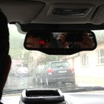 Taxi meter on rearview mirror