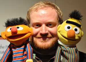Two Muppets and a man